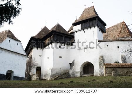 Transylvania, Romania. Image of fortified church of Viscri, UNESCO heritage site, german landmark in romanian country. - stock photo