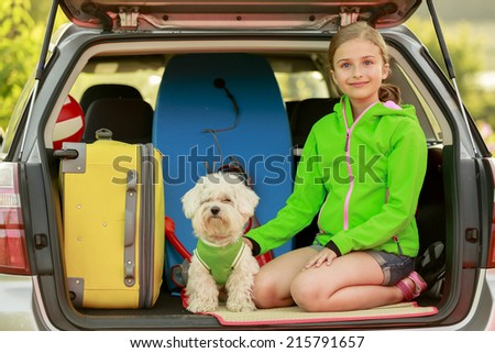 Travel - girl with dog ready for the travel for  vacation - stock photo
