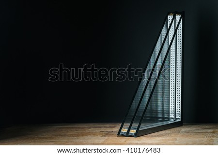triple glazing, wooden base, black background, place for text - stock photo