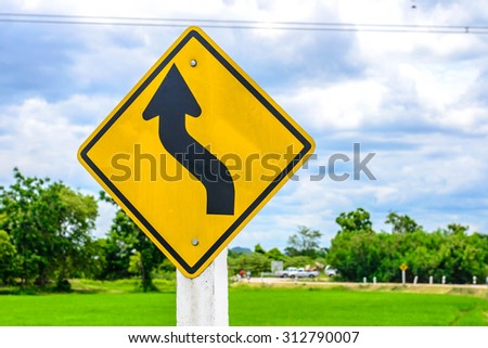 trun left with field , traffic sign  - stock photo