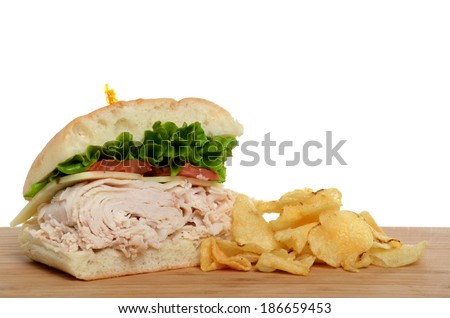 turkey sandwich with potato chips isolated white background - stock photo