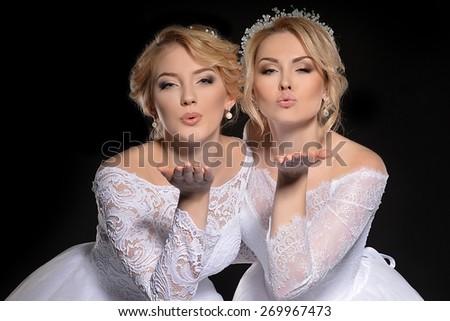 Two beautiful brides. Wedding hairstyle - stock photo