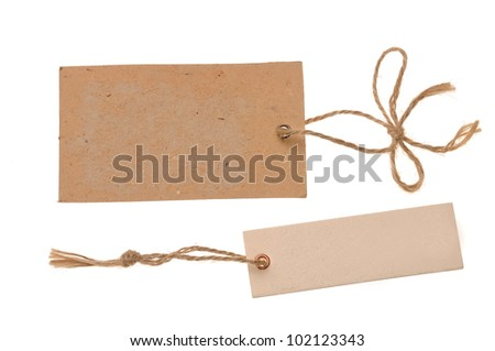 two blank cardboard paper labels or tag with strings isolated on the white background - stock photo