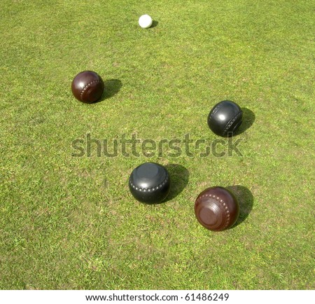 Two brown two black bowls and jack - stock photo