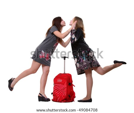 two girlfriends kiss and legs up on white - stock photo