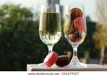Two glasses of French macarons and white wine/Two glasses of French macarons and white wine - stock photo