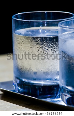 two glasses of icy water - stock photo