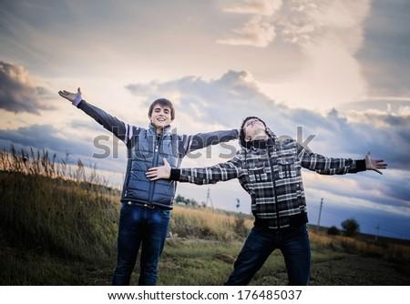 two happy teenagers outdoor - stock photo