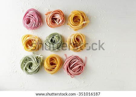 uncooked pasta mix on white, food top view - stock photo