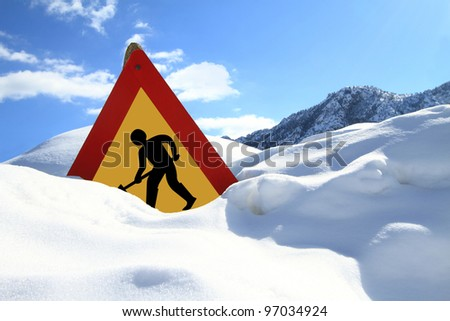 Under construction sign on snow - stock photo