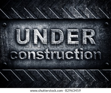 """under construction"" word on metal plate - stock photo"