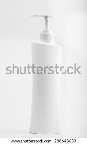 up Plastic bottle of skin care product on white background - stock photo