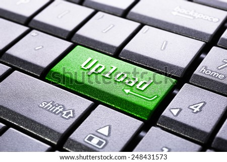 Upload button on the computer keyboard - stock photo