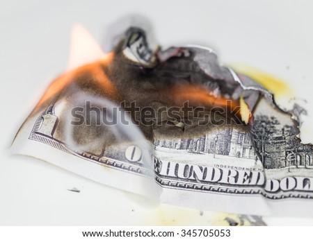 100 USD burn - stock photo