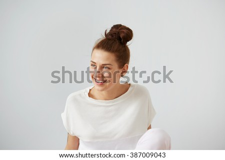 ?ute smiling woman. Closeup portrait woman looking happy. Sitting on the floor and relaxing in the bedroom at the weekend. Positive human emotion facial expression body language. Funny girl - stock photo