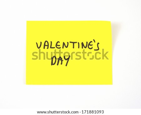 'Valentine's Day' written on a yellow sticky note - stock photo