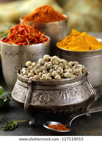 various spices (curcuma, paprika, saffron, coriander) in metal bowls - stock photo