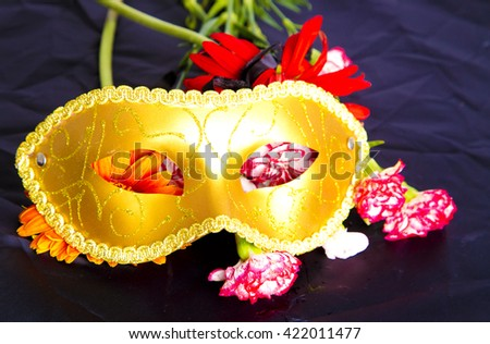 venice mask with flowers,red gerbera flower,eyes mask,flowers,venetia,italy,mask on black background,carnival ,art,traditional ,yellow on black,carnival, yellow, beautiful mask,elegant,celebration  - stock photo