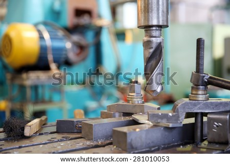 vertical drilling machine workplace at factory workshop - stock photo