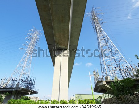 Viaduct and electric towers - stock photo
