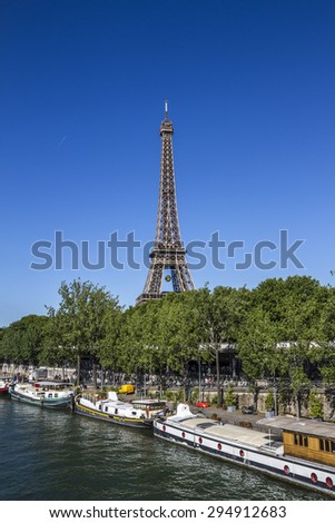 View Eiffel tower from the Seine River. Eiffel Tower is tallest structure in Paris and most visited monument in the world. France. - stock photo