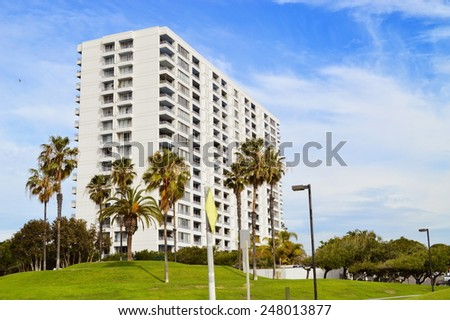 View of high-rises apartment building and palms. - stock photo