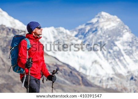 view of Mount Everest with beautiful sky and hiker, Sagarmatha national park, Nepal - stock photo