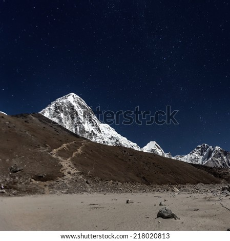 View of Mt. Everest in the Moonlight from Kala Patthar - Nepal, Himalayas - stock photo
