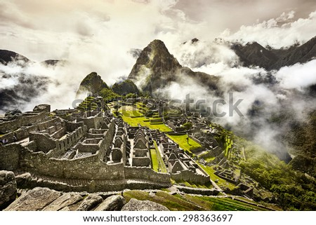 View of the ancient Inca City of Machu Picchu. The 15-th century Inca site.'Lost city of the Incas'. Ruins of the Machu Picchu sanctuary. UNESCO World Heritage site. - stock photo