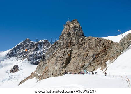 View of the  peak Jungfrau of Swiss Alpsand and the Sphinx Observatory, one of the highest astronomical observatories in the world, - stock photo