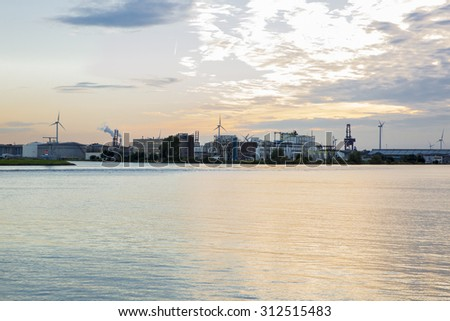 view of the port of Amsterdam, the biggest cocoa harbour in Europe, with its industrial installation, cranes and tanks - stock photo