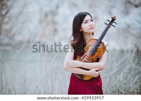 viola by a musician girl - stock photo