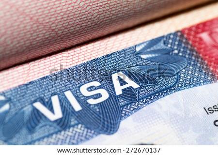 Visa stamp travel passport immigration macro emigration - stock photo