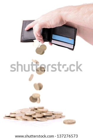 wallet emptying pound coins isolated on white - stock photo