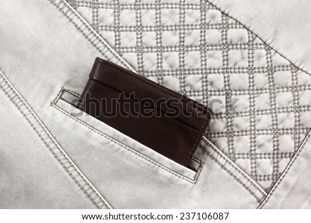 wallet sticking out of pocket - stock photo
