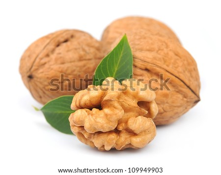 walnuts with leafs on white - stock photo