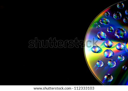 Water drops on CD wallpaper - stock photo