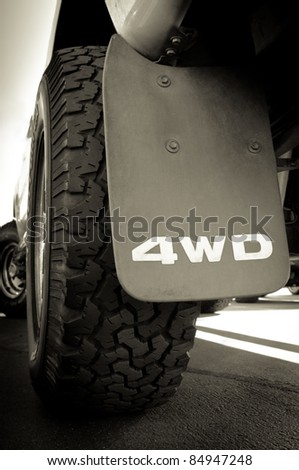"""""""4WD"""" sign and tire of a big truck - stock photo"""
