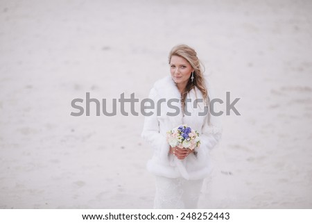 wedding on the beach in winter - stock photo