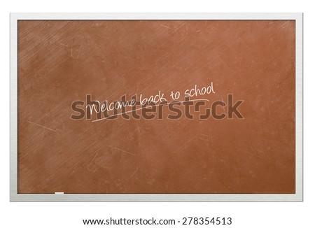 """Welcome back to school"" written on chalkboard - stock photo"