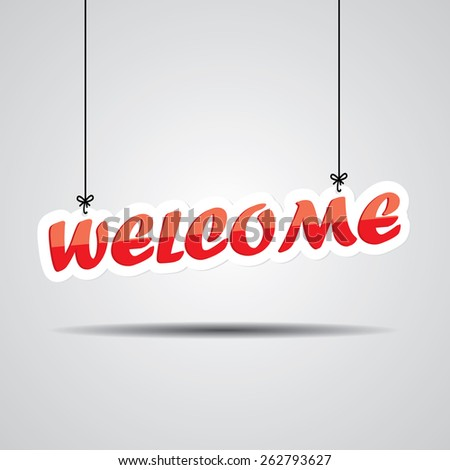 """Welcome"" Sign Hanging On Gray Background - stock photo"