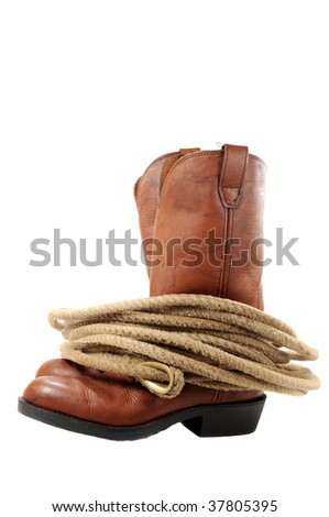 Western boots and rope isolated on white - stock photo