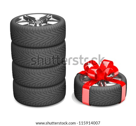 4 wheels and 5 as a gift. A tyre with a red ribbon like a present isolated on white background - stock photo