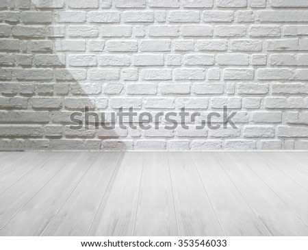 white brick wall and wooden floor with lighting and shadow, black and white - stock photo