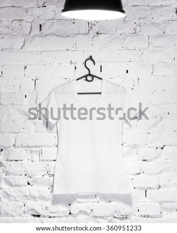 white front t-shirt on a white wall - stock photo
