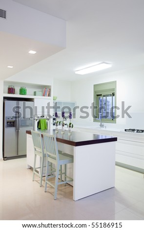 White  luxury kitchen in a  new modern home - stock photo