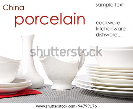 White porcelain plates, cups, saucers - stock photo