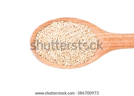 white quinoa seeds on a wooden spoon isolated, healthy food - stock photo