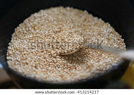 white sesame seeds with spoon, close up spoon pick up  white sesame seeds for cooking blur background - stock photo