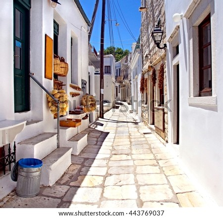 white washed picturesque Sunny alley at the Cyclades Island of Naxos , Greece - stock photo